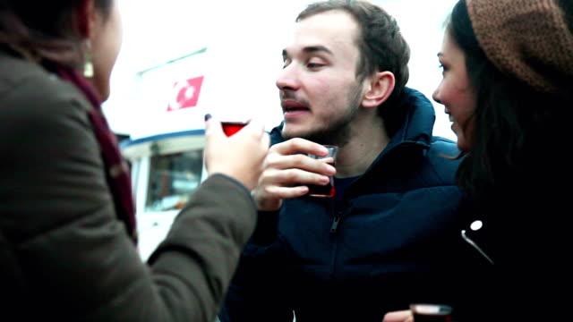 Happy friends drinking tea in a cafe video