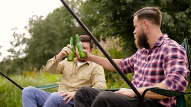happy friends fishing and drinking beer