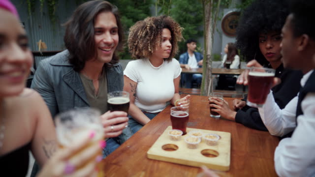 happy friends having a great time at the pub - birra video stock e b–roll