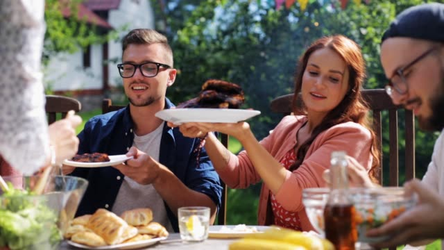 happy friends having dinner at summer garden party - bbq stock videos & royalty-free footage