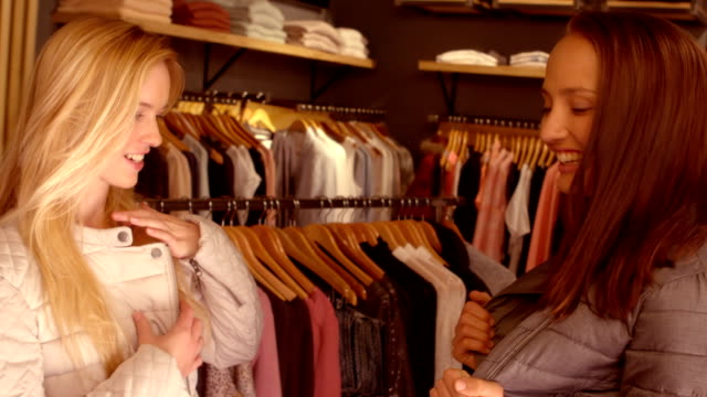 Happy friends shopping together in the mall video