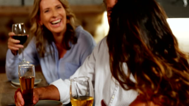 happy friends talking to each other while having drink 4k 4k - 40 49 lat filmów i materiałów b-roll