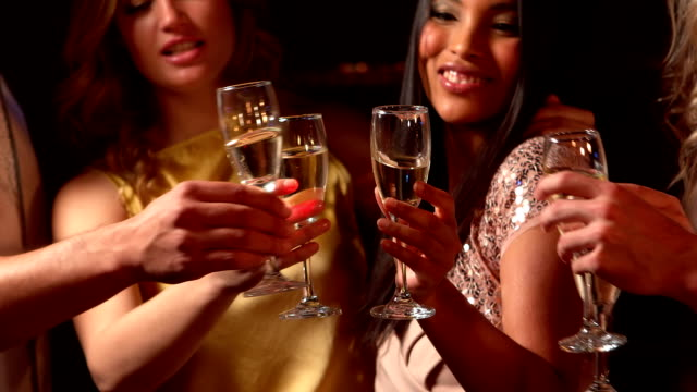 Happy friends toasting with champagne video