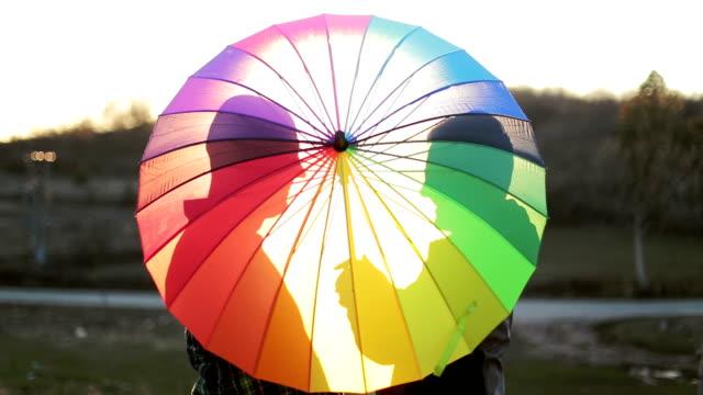 happy gay couple behind the umbrella video