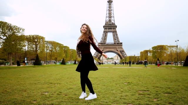 Happy girl enjoying Paris