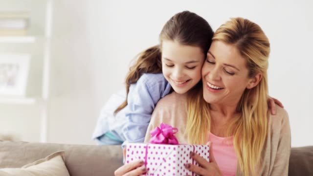 happy girl giving present to mother at home - mothers day stock videos & royalty-free footage