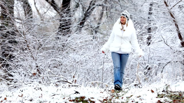 Happy girl in snowy forest. video