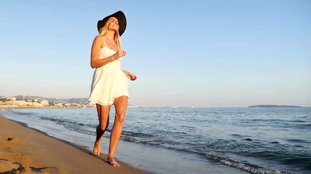 Happy girl on beach video