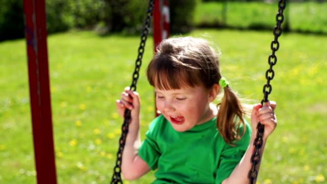 SLOW MOTION: Happy Girl Swinging video