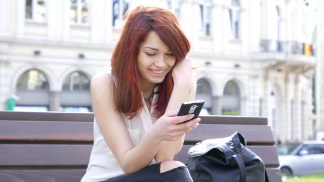 Happy girl text messaging video