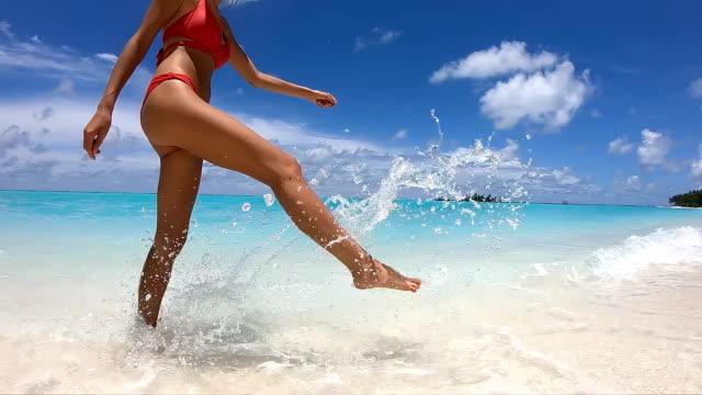 Happy Girl Walks on the Beach on Maldives