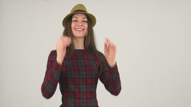 happy girl wearing hat - young singles stock videos and b-roll footage