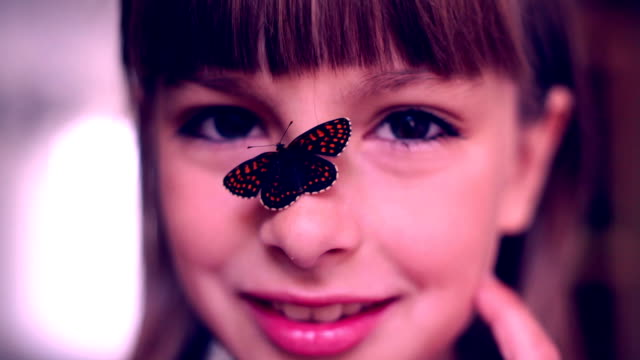 Happy Girl with a butterfly on her nose video