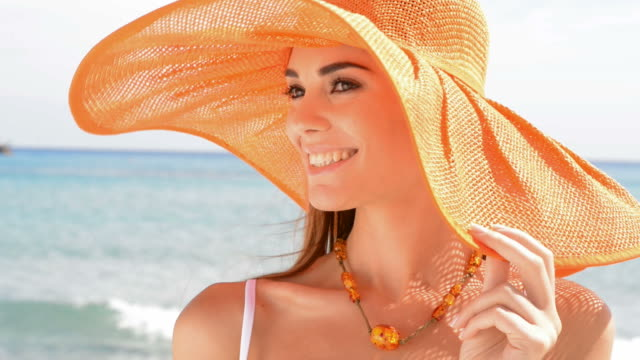 happy girl with orange hat at the sea - beach fashion stock videos and b-roll footage