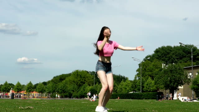Happy girls in short shorts jump in slow motion video