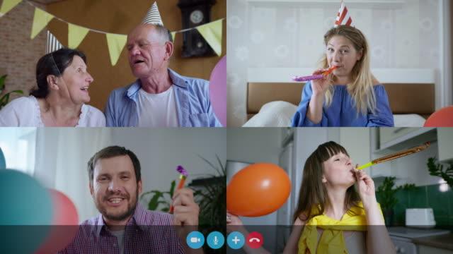 glad morfar och mormor sjunga en sång under virtuella online födelsedagsfest, personer med ballonger blåsa rör på webbkamera, datorskärm collage view - birthday celebration looking at phone children bildbanksvideor och videomaterial från bakom kulisserna