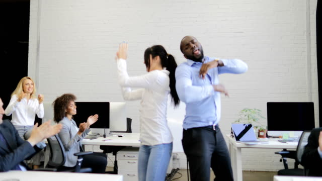 Happy Group Of Business People Dancing In Modern Coworking Space, Mix Race Businesspeople Team Having Fun On Break video