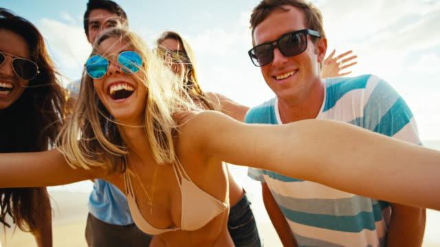 Happy group of friends having fun taking selfie video