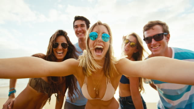Happy group of friends having fun taking selfie video