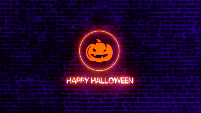 4k happy halloween neon sign on brick wall |loopable - halloween background filmów i materiałów b-roll