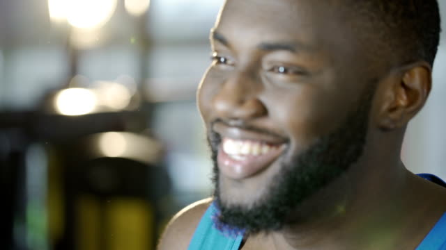 Happy handsome man smiling, touching beard, satisfied with barbershop services video