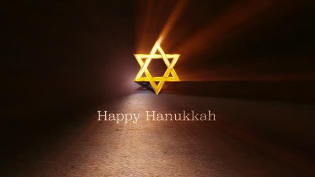 vídeos y material grabado en eventos de stock de feliz hanukkah. animación 3d de la mano letras escrito con letras de oro, estrella de david y menorah. - hanukkah