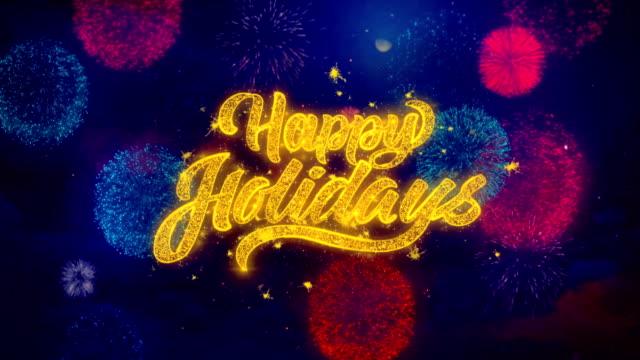 vídeos y material grabado en eventos de stock de happy holidays 2 texto firework saludo texto de destello partículas en fuegos artificiales de colores - happy holidays