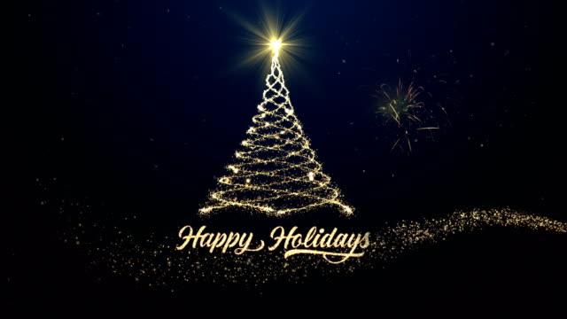 vídeos de stock e filmes b-roll de happy holidays christmas tree background with fireworks - christmas card