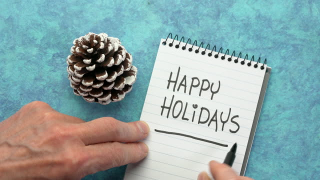 happy holidays - man hand writing a note with a black marker - happy holidays stock videos & royalty-free footage