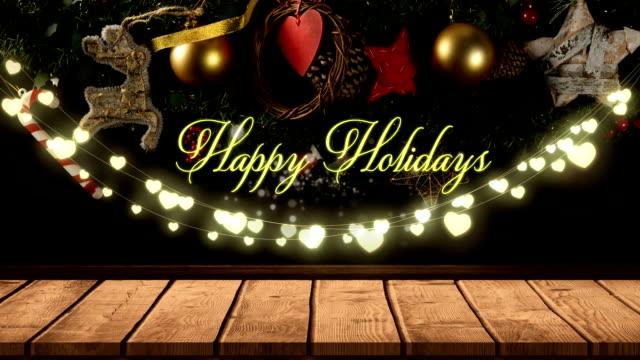 vídeos y material grabado en eventos de stock de felices fiestas con una cadena brillante de luces de hadas - happy holidays
