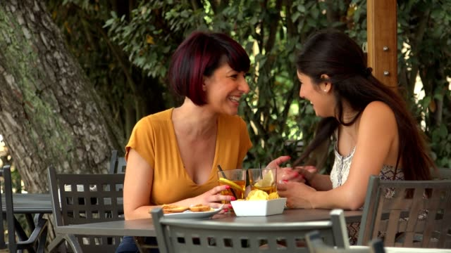 happy hour between two young friends: relax, chat, gossip happy hour between two young friends: relax, chat, gossip aperitif stock videos & royalty-free footage