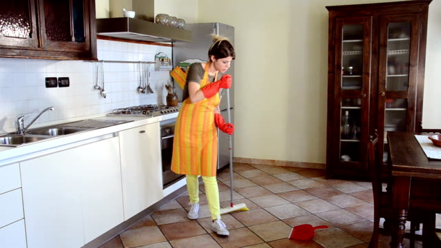 Happy housewife cleaning and dancing video