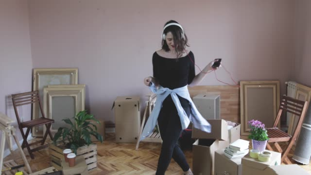 Happy In New Home Cheerful young woman have a fun in new home house rental stock videos & royalty-free footage