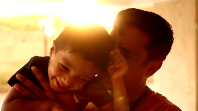 Happy Indian child playing with his father Happy Indian child playing with his father. indian culture stock videos & royalty-free footage