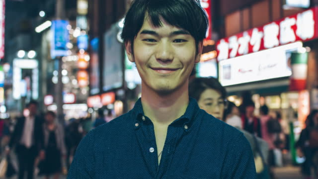 Happy Japanese young man Happy Japanese young man in Shibuya. handsome people stock videos & royalty-free footage