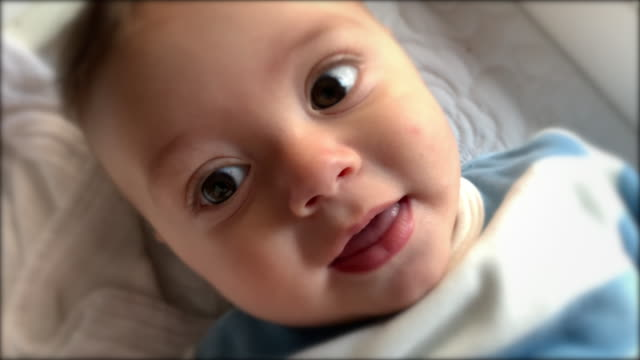 happy joyful baby infant laugh smiling looking to camera - 0 11 mesi video stock e b–roll