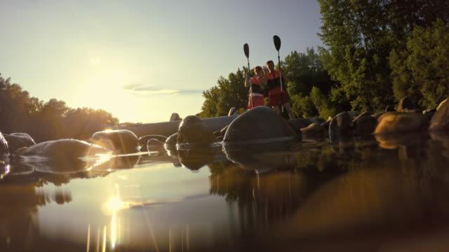 Happy kayakers waving at the camera video