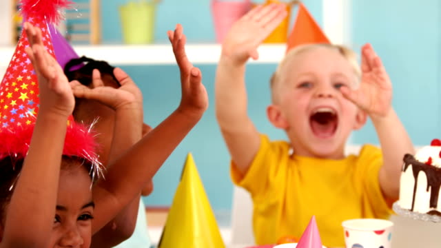 Happy kids at a birthday party video