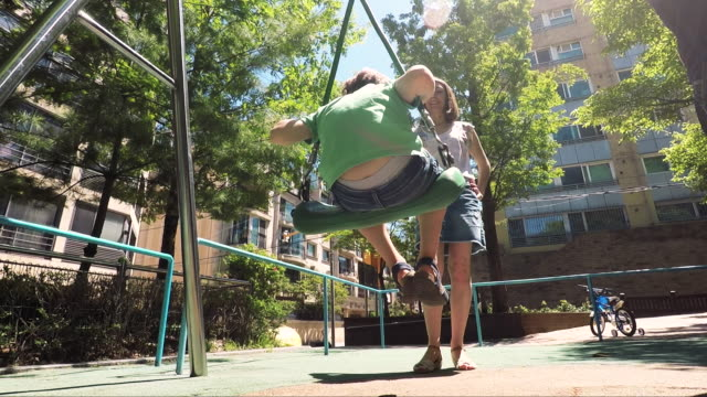 Happy kids playing outdoor at the park Happy kids playing outdoor at the park outdoor play equipment stock videos & royalty-free footage