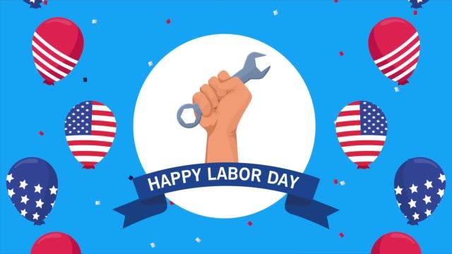 バルーンヘリウムで手持ち揚げレンチとusaフラグと幸せな労働日のお祝い - 拳 イラスト点の映像素材/bロール