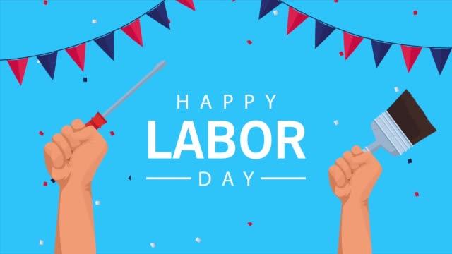手を持ち上げるツールと花輪で幸せな労働日のお祝い - 拳 イラスト点の映像素材/bロール