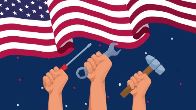 アメリカの旗と手持ち上げツールで幸せな労働日のお祝い - 拳 イラスト点の映像素材/bロール