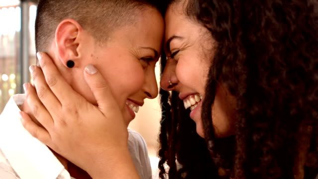 happy lesbian couple smiling face to face - same sex couples stock videos and b-roll footage