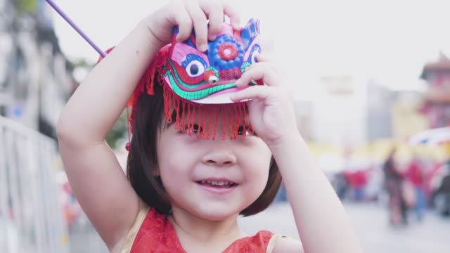 Happy little asian girl Celebrating Chinese new year Happy little asian girl Celebrating Chinese new year chinese new year stock videos & royalty-free footage
