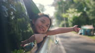 istock 4K Happy little Asian girl enjoy and having fun with parents in the car on road trip vacation. 1308779422