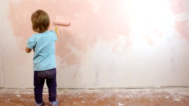 Happy little baby painting the wall video