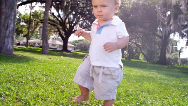 Happy Little Boy Practicing Walking Park Grass video