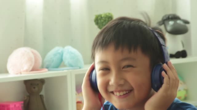 Happy little boy with listen to music
