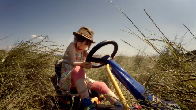 GENDER NEUTRAL KIDS. A Happy Little Girl Drive Go-chart, Off-Road. Happy Memories Of Her Young Days video