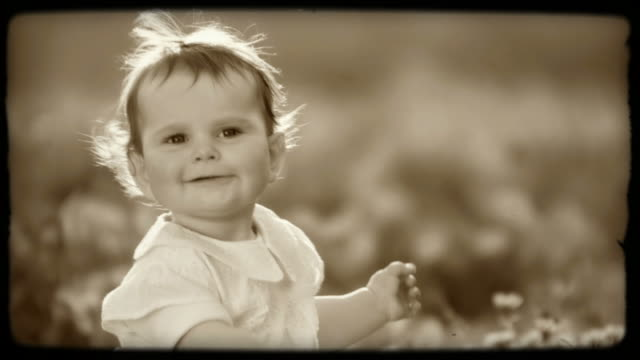 HD SLOW-MOTION: Happy Little Girl  sepia toned stock videos & royalty-free footage
